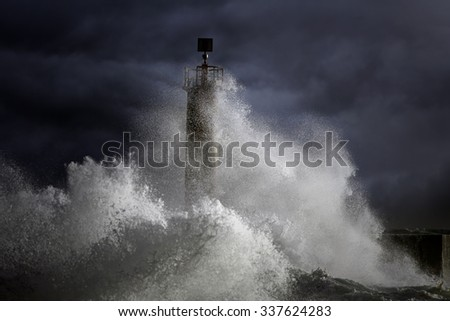 Big Atlantic stormy waves over lighthouse. North of Portugal. Enhanced sky - stock photo