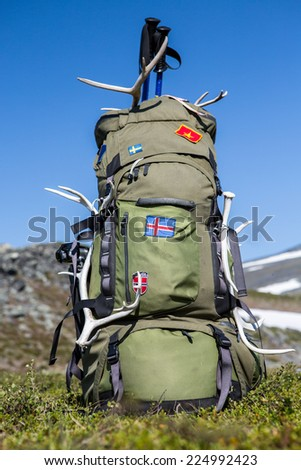 Big backpack with flags - stock photo