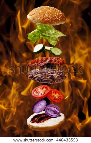 big bacon barbecue burger on fire flame grill background - stock photo