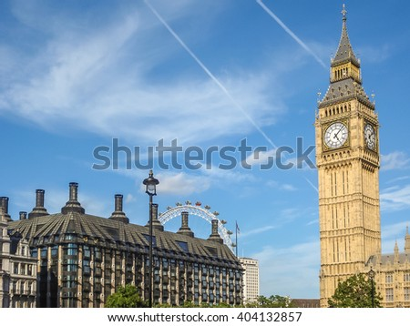 Big Ban Elizabeth tower clock face, Palace of Westminster and London Eye in background, London, UK - stock photo