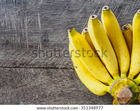 Big banana top view on wooden with copy space - stock photo