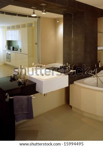 big bathroom with glass wall - stock photo