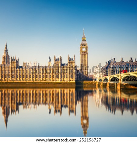 Big Ben and Houses of parliament at calm sunny morning - stock photo