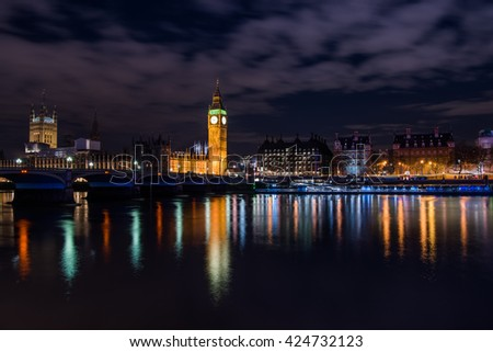 Big Ben and Houses of Parliament reflecting on the Thames, London, UK - stock photo