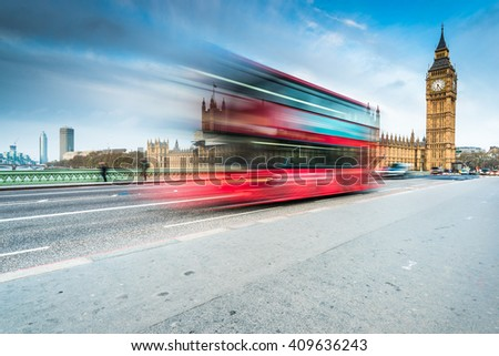 Big Ben and landmark bus on Westminster Bridge in London at early morning blue hour - stock photo