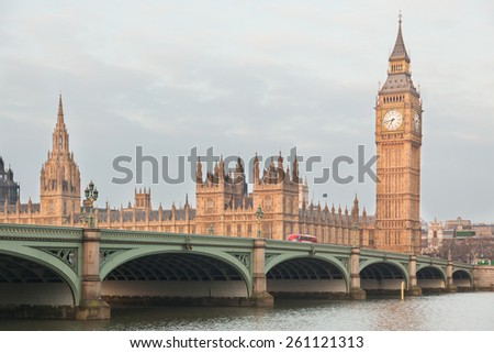 Big Ben and Parliament building at early morning in London with Westminster bridge and Thames river in foreground - stock photo