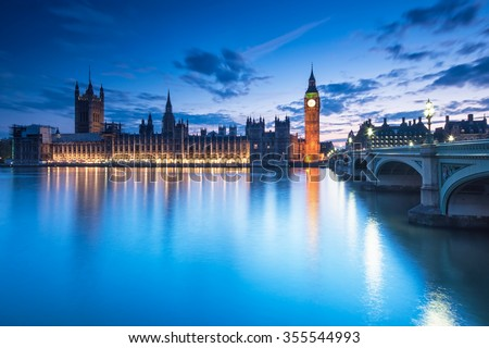 Big Ben and the Houses of Parliament at night in London, UK - stock photo