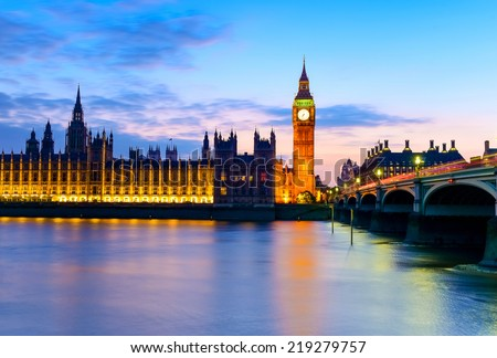 Big Ben and Westminster abbey at night in London, UK - stock photo