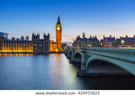 Big Ben and Westminster Bridge in London at night, UK - stock photo
