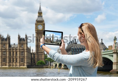 Big Ben on the screen of a tablet - stock photo