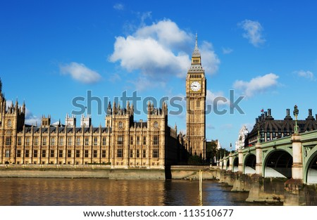 Big Ben on the thames with blue sky - stock photo
