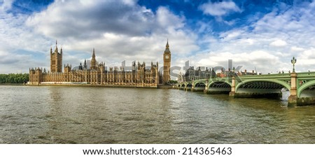 Big Ben, Parliament Building and Westminster Bridge on a beautiful sunny afternoon. - stock photo