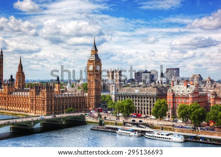 Big Ben, Westminster Bridge on River Thames in London, the UK. English symbol. Lovely puffy clouds, sunny day - stock photo