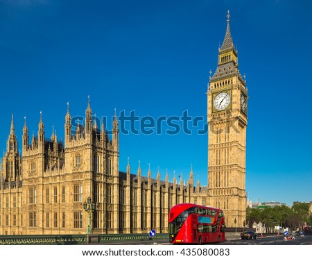 Big ben with a red bus in London - stock photo