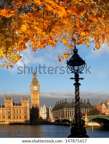 Big Ben with autumn leaves in London, England - stock photo