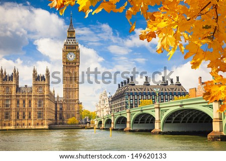 Big Ben with autumn leaves, London - stock photo