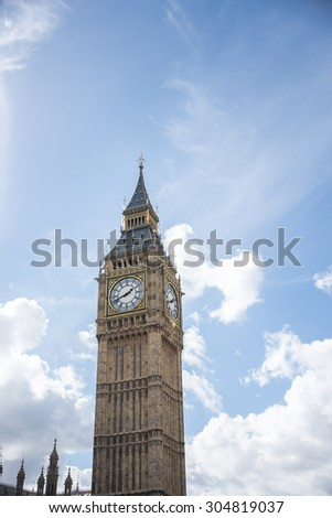 Big Ben with blue sky background in London, UK - stock photo