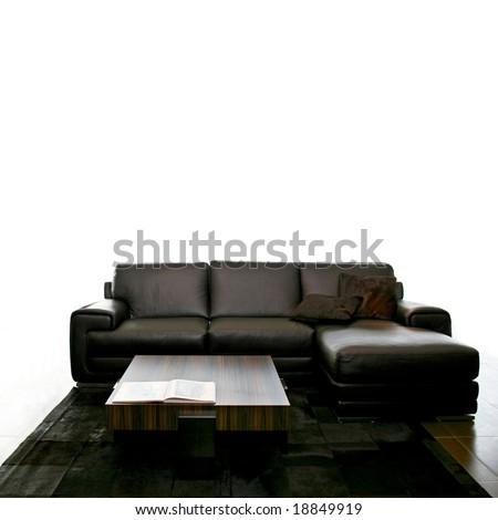 Big black leather sofa isolated on white - stock photo