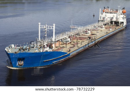 Big blue barge on Volga River - stock photo