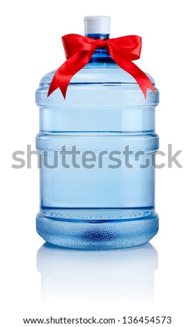 Big bottle of water tied with a red satin ribbon bow Isolated on white background - stock photo