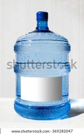 Big bottle of water with label on a white background - stock photo