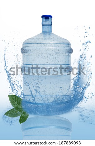 big bottle with clean blue water drink and green foliage  - stock photo