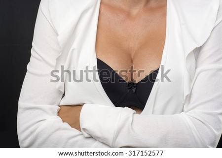 Big Breasts Lady In Black Sexy Bra and White Jacket - stock photo