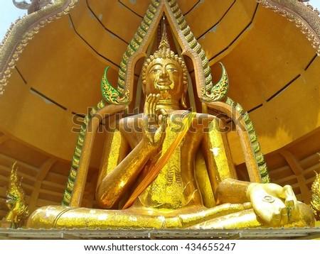 Big Buddha statue at Wat Tham Sua, Kanchanaburi Province, Thailand - stock photo