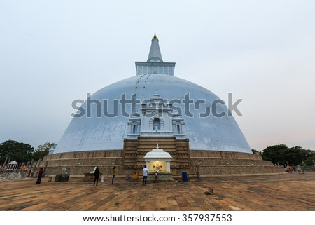 Big buddhist stupa at Anuradhapura in Sri Lanka at sunset - stock photo