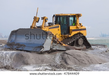 Big bulldozer on the beach - stock photo
