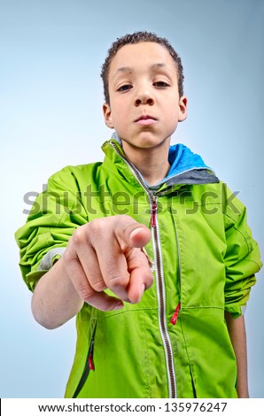 Big bullying kid looking for trouble - stock photo
