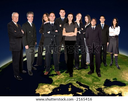 big business team on top of the world - europe version - globe from nasa.gov - stock photo