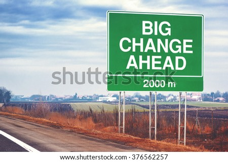 Big change ahead conceptual motivational image with road sign by the highway, retro toned image with selective focus - stock photo
