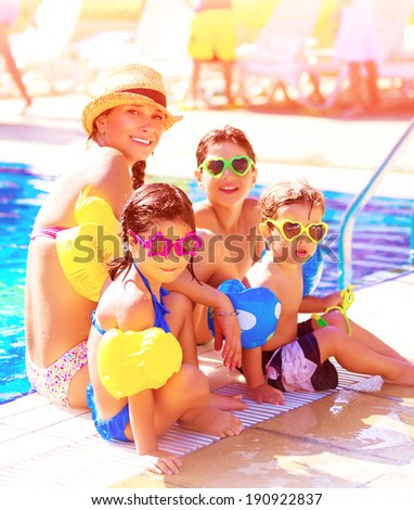 Big cheerful family having fun on beach resort, active lifestyle, spending time together near poolside, summer vacation and traveling concept - stock photo