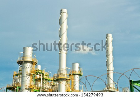 Big chimney in petrochemical plant in cloudy day - stock photo