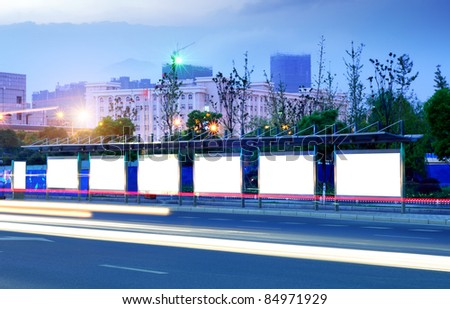 Big cities at night, roadside billboard blank. - stock photo