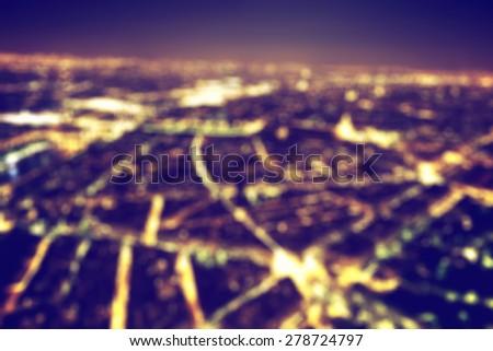 Big city night lights bokeh, blurred background. Vintage style, nightlife blur - stock photo