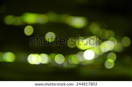 Big city road car lights at night.The out-of-focus light spot.. - stock photo