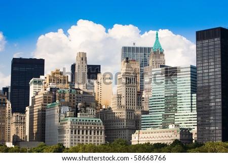 big city skyline under blue sky - stock photo