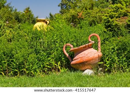 Big clay pots as garden decorative elements  - stock photo