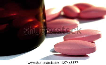 Big Close Up of Multivitamin and Calcium. - stock photo