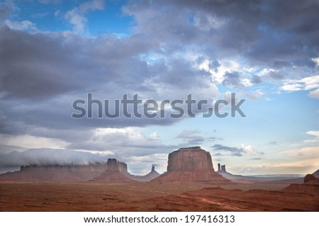 big cloud on mesa in Monument Valley. Sandstone formation in Monument Valley before thunder. - stock photo