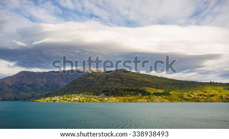 big cloud over the Remarkables mountain in Queenstown, New Zealand - stock photo