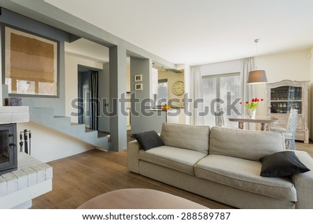 Big comfortable couch in modern living room - stock photo