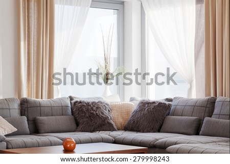 Big comofrtable sofa in bright contemporary lounge - stock photo