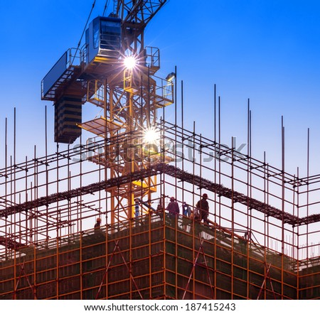 Big Construction Site with Working Cranes at dusk for Business  - stock photo