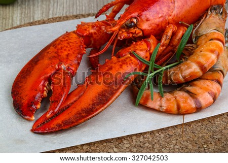 Big cooked lobster and tiger shrimps ready for eating - stock photo