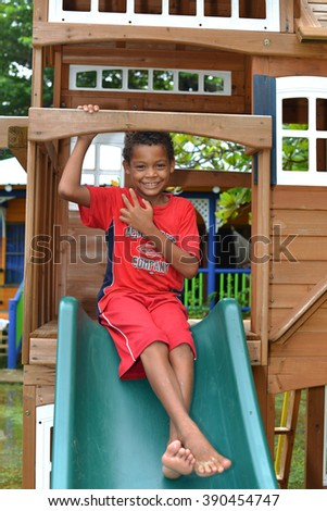 BIG CORN ISLAND, NICARAGUA-NOV. 15: Unidentified boys have fun in child's playhouse in Big Corn Island, Nicaragua, Central America on November 15, 2015. - stock photo