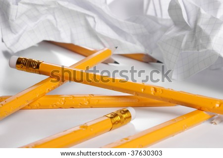 Big creativity crisis - chewed pencils and crushed paper - stock photo