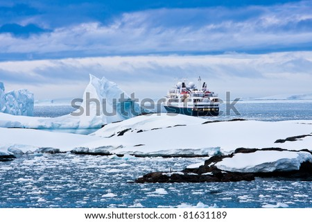 Big cruise ship in the Antarctic waters - stock photo